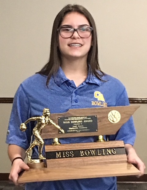 """Division II Bowler of the Year, Leah Hayes holding trophy that reads """"Miss Bowling"""""""
